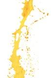 在白色背景隔绝的橙汁飞溅 免版税库存图片