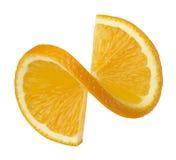 在白色背景隔绝的橙色扭转的切片 库存照片
