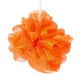 在白色背景隔绝的橙色海绵阵雨 免版税库存图片