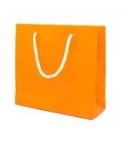 在白色背景隔绝的橙色纸袋 库存图片