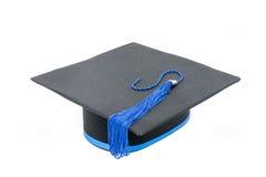 在白色背景隔绝的毕业帽子 库存图片