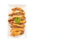 在白色背景隔绝的油煎的酥脆猪肉 免版税图库摄影