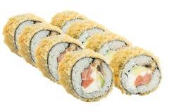 在白色背景隔绝的温暖的寿司卷 库存图片