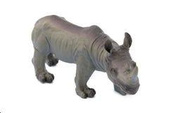 在白色背景隔绝的灰色犀牛玩具 库存图片