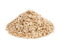 在白色背景隔绝的燕麦剥落。健康吃 免版税库存照片