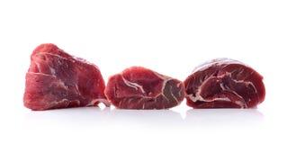 在白色背景隔绝的牛肉 库存图片