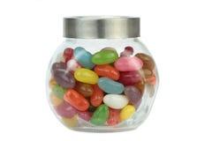 在白色背景隔绝的瓶子的五颜六色的软心豆粒糖 图库摄影