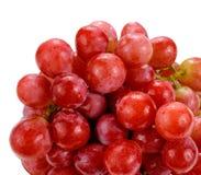 在白色背景隔绝的甜红葡萄 库存图片