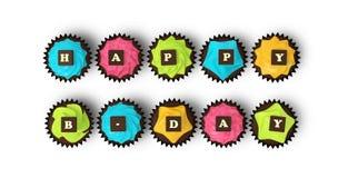 在白色背景隔绝的生日快乐杯形蛋糕 库存照片