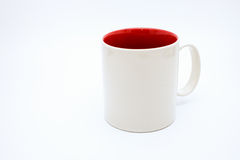 在白色背景隔绝的白色杯子 免版税图库摄影