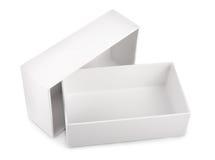 在白色背景隔绝的白色空白的箱子 库存照片