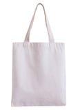 在白色背景隔绝的白色织品袋子 免版税库存照片