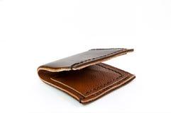 在白色背景隔绝的皮革棕色钱包手工制造 库存图片