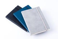 在白色背景隔绝的皮革笔记本 免版税库存照片