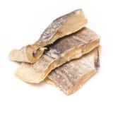 在白色背景隔绝的盐味的鳕或盐渍鳕鱼 免版税库存照片