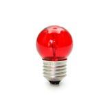 在白色背景隔绝的红灯电灯泡 免版税库存照片