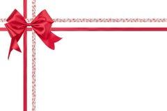 在白色背景隔绝的红色丝带弓 库存图片