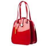 在白色背景隔绝的红色光滑的女性皮革提包 图库摄影