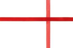 在白色背景隔绝的红色发光的丝带 免版税库存照片