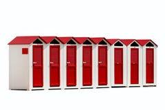 在白色背景隔绝的红色和白色海滩客舱 库存照片