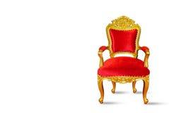 在白色背景隔绝的红色和金黄豪华椅子 库存图片