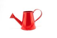 在白色背景隔绝的红色喷壶 免版税图库摄影
