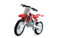 在白色背景隔绝的红色摩托车玩具红色, 免版税库存图片