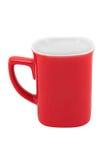在白色背景隔绝的红色杯子 免版税库存照片