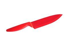 在白色背景隔绝的红色陶瓷刀子 库存照片