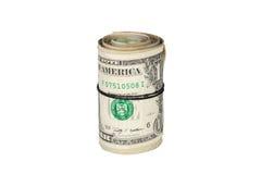 在白色背景隔绝的美元扭转的卷  免版税库存照片