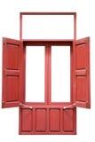 在白色背景隔绝的老红色木双窗口开放 库存图片