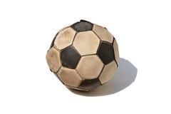 在白色背景隔绝的肮脏的足球 免版税库存照片