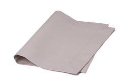 在白色背景隔绝的自然亚麻布餐巾 免版税库存图片