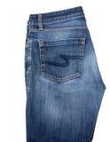 在白色背景隔绝的蓝色人` s牛仔裤 免版税库存图片