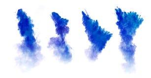 在白色背景隔绝的蓝色尘末爆炸 免版税库存照片