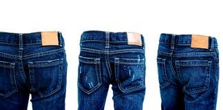 在白色背景隔绝的蓝色牛仔裤拼贴画  库存图片
