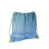 在白色背景隔绝的蓝色牛仔裤袋子 库存图片