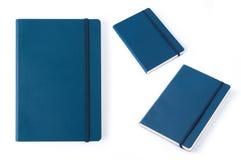 在白色背景隔绝的蓝色皮革笔记本 免版税图库摄影