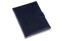 在白色背景隔绝的蓝色皮革笔记本 免版税库存图片