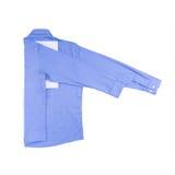 在白色背景隔绝的蓝色衬衣 图库摄影
