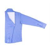 在白色背景隔绝的蓝色衬衣 免版税图库摄影