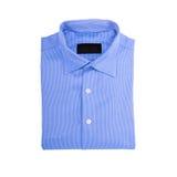 在白色背景隔绝的蓝色衬衣 免版税库存图片