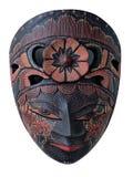 在白色背景隔绝的蜡染布木面具纪念品 免版税库存照片