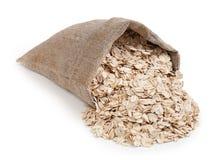 在白色背景隔绝的袋子的燕麦片 免版税库存照片