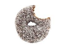 在白色背景隔绝的被咬住的椰子巧克力多福饼 免版税库存图片