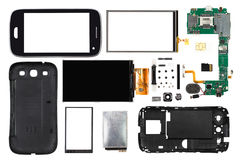 在白色背景隔绝的被拆卸的智能手机 库存图片