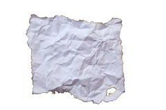 在白色背景隔绝的被烧的纸 库存图片