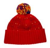 在白色背景隔绝的被编织的帽子 有绒球的帽子 库存图片