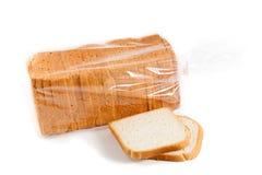 在白色背景隔绝的裁减面包 库存图片