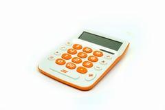 在白色背景隔绝的计算器橙色按钮 图库摄影